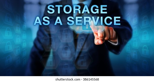 Virtual architect touching STORAGE AS A SERVICE on an interactive screen. Business model metaphor and information technology concept for offsite backup via the infrastructure of a service provider.