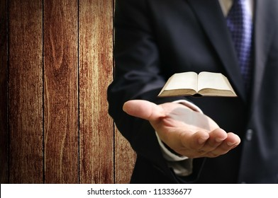 Virtual book on businessman hand, Searching technology