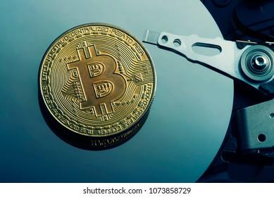 Virtual Coins BitCoins on hard disk surface