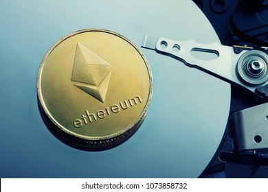 Virtual Coins Ethereum on hard disk surface
