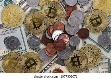 Virtual cryptocurrency money Bitcoin golden coin on United States US twenty dollar bill ($20) with the faces of President Andrew Jackson and US coins - cents.