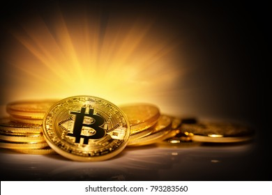 Virtual currency bitcoin on pile of scattered coins in bright rays. The concept of extraction and development of a new modern currency and virtual business.