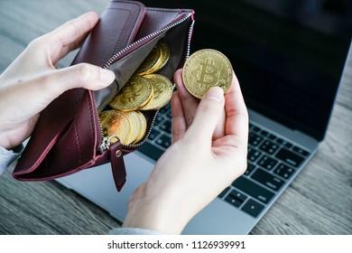 Virtual currency wallet gold bitcoin. bitcoin laptop wallet. Bitcoin in hand.