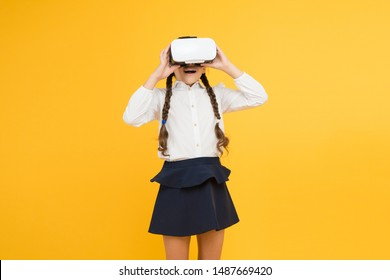 Virtual education. Insights into immersive virtual reality in real classrooms. Changing digital experiences way we learn and create. Digital virtual future and innovation. Little child in VR headset.