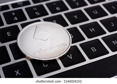 Virtual Ethereum coin currency finance money on computer laptop keyboard