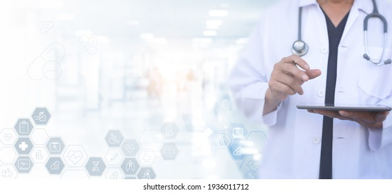 Virtual hospital, telemedicine, medical online, E-health, healthcare , modern technology concept. Doctor working on digital tablet with medical icons on virtual screen with blurred hospital background