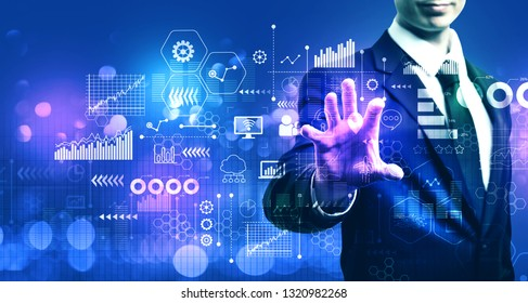 Virtual icons and graphs with businessman on blurred blue light background