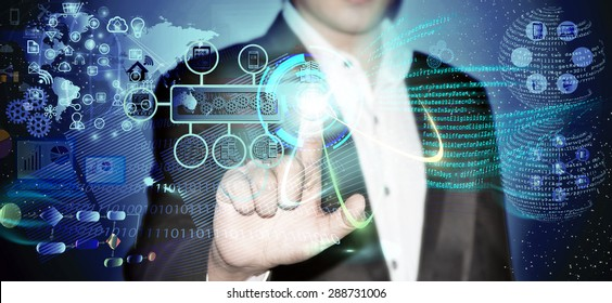 Virtual image of a Business man touching the process of triggering a software development process, which it connects the various systems globally through a single touch in a network and coding phase.
