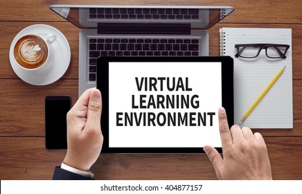 VIRTUAL LEARNING ENVIRONMENT, on the tablet pc screen held by businessman hands - online, top view