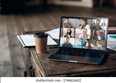 Virtual meeting online. Video conference by laptop. Online business meeting. On the laptop screen, people who gathered in a video conference to work on-line, near stands a cup of coffee - Shutterstock ID 1746616652