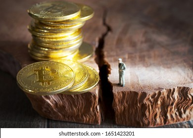 virtual money Bitcoin cryptocurrency - halvings the Bitcoins currency - gold coin on the wooden background with a symbolical halving