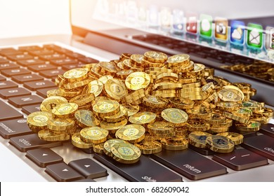 Virtual money and cryptocurrency mining concept, pile of bitcoin gold coins on a computer keyboard, 3d illustration