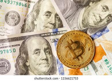 virtual money golden bitcoin on hundred dollars bills background. Exchange bitcoin cash for a dollar.