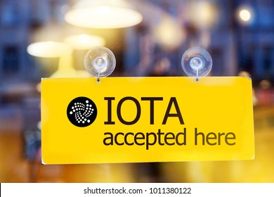virtual money IOTA cryptocurrency -  Iota (MIOTA) currency accepted here - sign on glass door