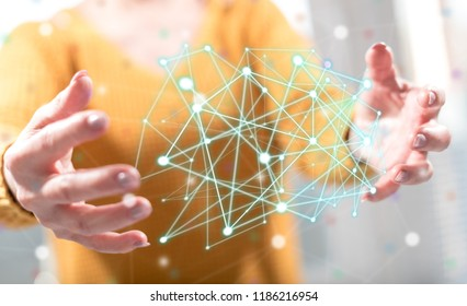 Virtual network concept between hands of a woman in background