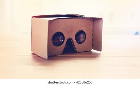 Virtual reality cardboard headset on a table in natural light