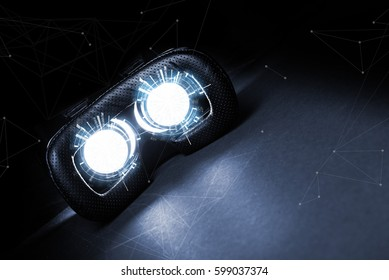 Virtual reality concept. Man or women holding in Hand VR glasses device with futuristic image in lens light