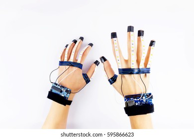 Virtual reality. Engineer working in virtual gloves. Microcontrollers connected to the fingers of engineer