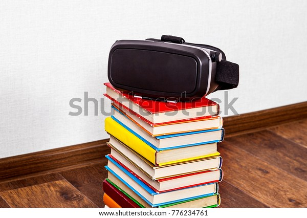 Virtual Reality Glasses on the Books by the Wall