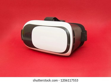 Virtual reality helmet isolated on the red background