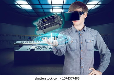 Virtual reality in mechanical engineering. 3d engineer in shirt looking through vr glasses at engine for heavy industry on futuristic plant background with control panels.