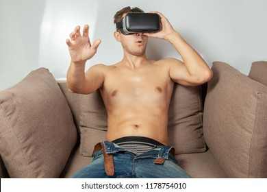 Virtual sex in VR glasses. Man is naked and in VR glasses of virtual reality has sex.