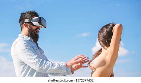Virtual sexual activity. Man touch sexy naked erotic breasts virtual girl. Explore cybersex. Play virtual sex game. Intimate sensation concept. Hipster man play virtual sex game hmd or vr glasses.