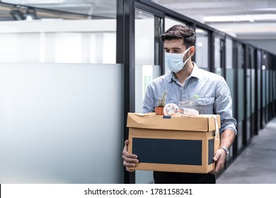 Virus Covid 19 crisis business due to outbreak of Coronavirus Disease 2019 or COVID-19, Unemployed man leaves of workplace, Dismissal from work. Job loss. Reduction of the company's staff.Unemployment