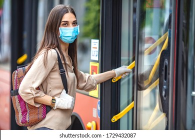 Virus pandemic and pollution concept. Woman getting on the bus. Virus protection in public transportation. Woman wearing surgical protective mask going to work