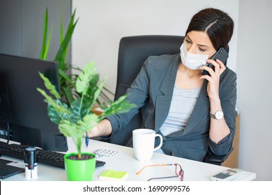 Virus.Woman at the office sick with mask for corona virus. Business women wear masks to protect and take care of their health. Home working with computer. Working from home.