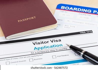 Visa application form with red passport, pen, and boarding pass