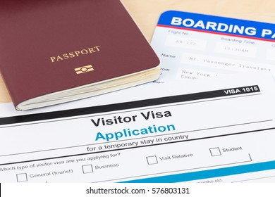 Visa application form with red passport, and boarding pass