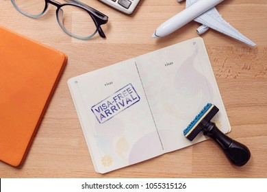 visa free arrival stamp on foreign passport with airplane model. oversea travel in visa free arrival country concept