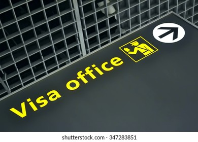 visa office direction sign for travelers in airport, immigration service, travel diversity