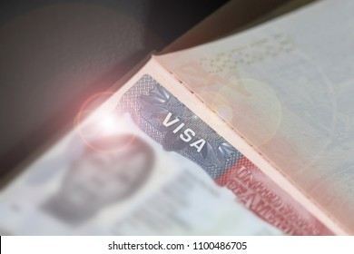 Visa stamp travel passport immigration macro emigration. Close up of text VISA on USA visa stamp in passport. A visitor needs a valid US visa to present to the CBP officer .