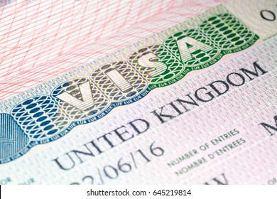 Visa to UK. United Kingdom visa vignette in passport. Macro image, selective focus
