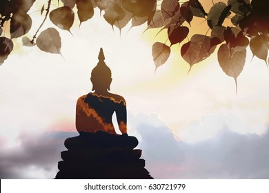 Visakha Puja Day , Buddha statue , buddha statue and silhouette  sky with double exposure