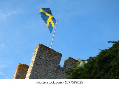 Visby City Wall and the Swedish flag, Gotland Sweden.