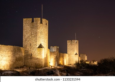 Visby Old Town Walls in starry winter night, Gotland, Sweden
