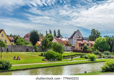 Visby on island Gotland in Sweden, August 2,2017: Park Almedalen. The best-preserved historical medieval city in Scandinavia. Beautiful view with color old buildings, lake, resting or relaxing people.