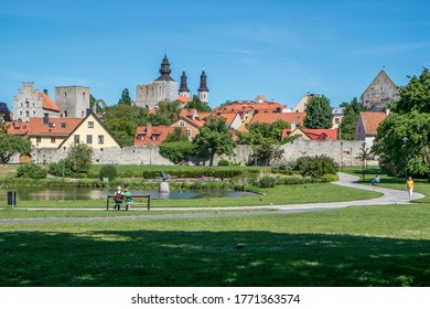 """VISBY, SWEDEN - JUNE 10, 2014: Famous park Almedalen in medieval Visby. Almedalen hosts """"politicians week"""" annually the first week in July since 1982 which gathers leading politicians and parties in S"""