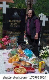 Visegrad, Bosnia and Herzegovina - June 09, 2013 : A Serbian mother, who lost her son in the Yugoslavia war in the city of Serbia in the Republic of Serbia in Bosnia and Herzegovina, prays at the grav