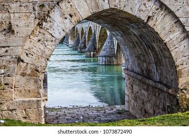 VISEGRAD, BOSNIA AND HERZEGOVINA - March 2018: Visegrad bridge, historical ottoman bridge in Serbian republic of Bosnia and Herzegovina. Unesco World Heritage Site