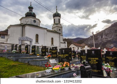 VISEGRAD, BOSNIA and HERZEGOVINA - March 2018: Orthodox Church of the Virgin Mary and cemetery nearby in Viserad, close to Serbia town in Bosnia and Hertzegovina