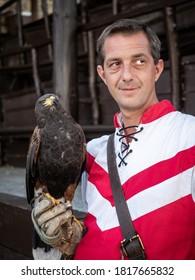 VISEGRAD, HUNGARY - 08/27/2020: Portrait of caucasian man with hawk.