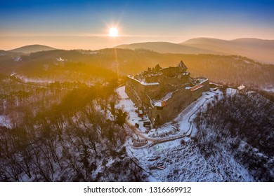 Visegrad, Hungary - Aerial view of the beautiful old high castle of Visegrad at sunrise on a winter morning with snow