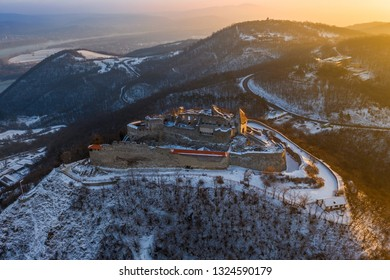Visegrad, Hungary - Aerial view of the beautiful old and snowy high castle of Visegrad at sunrise on a winter morning