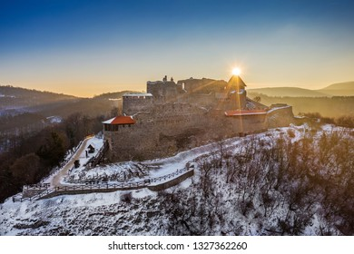 Visegrad, Hungary - Aerial view of the beautiful snowy high castle of Visegrad at sunrise on a winter morning