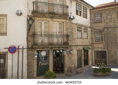Viseu, Beira, Portugal, July 20, 2016: hardware store entrance with metal containers. July 20, 2016 in Viseu, Portugal