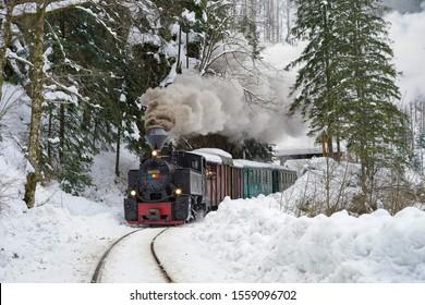 Viseu de Sus, Maramures, Romania -  January 25 2019 - Steam Train in winter time Romania